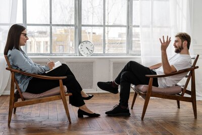 Counselor and client in a counseling-session