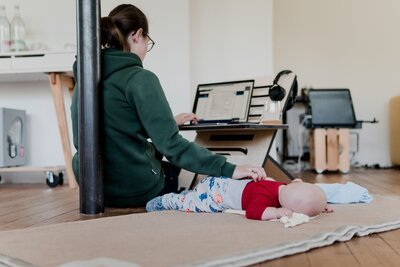Woman working from home with her baby