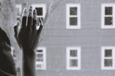 Woman grieving at a window