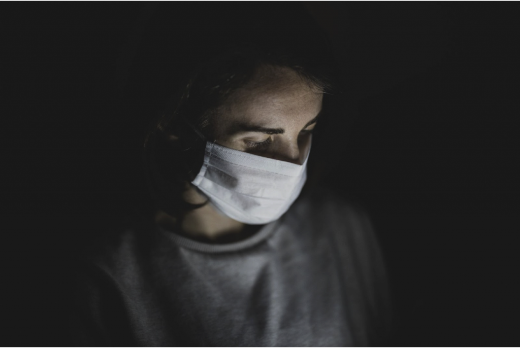 woman with a mask in the dark